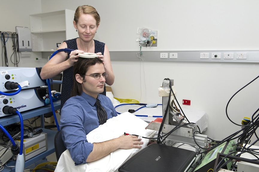 PhD candidates Siobhan Fitzpatrick and Jim Nuzzo, using transcranial magnetic stimulation to activate the motor cortex.